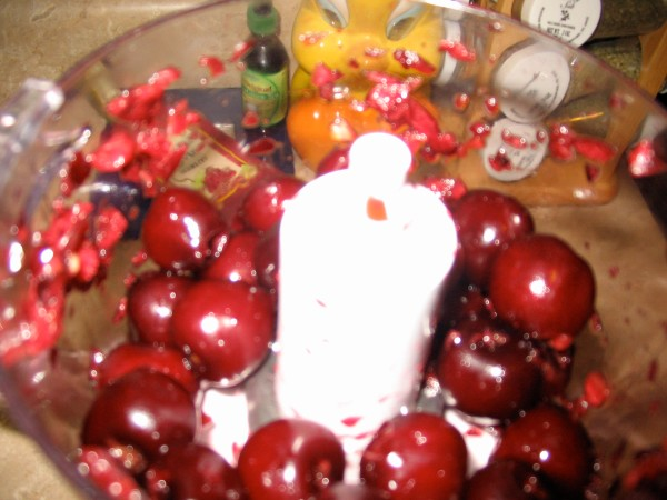 Chopping up the previously pitted cherries